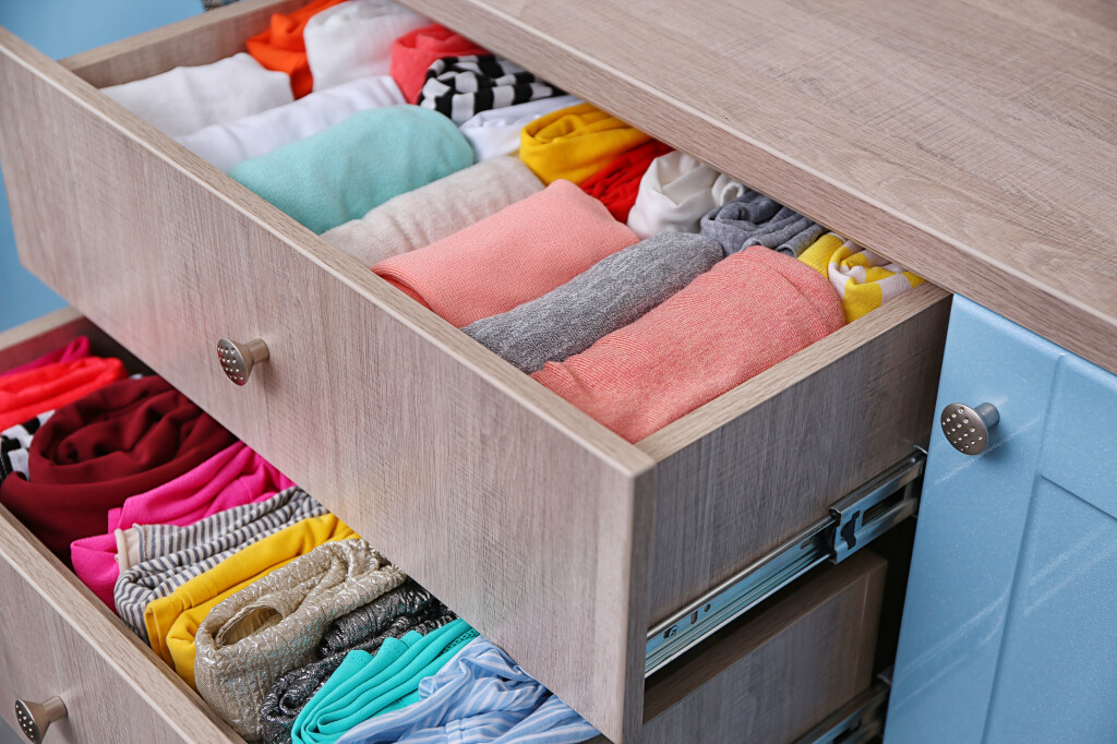 Neatly,Folded,Clothes,In,Chest,Of,Drawers